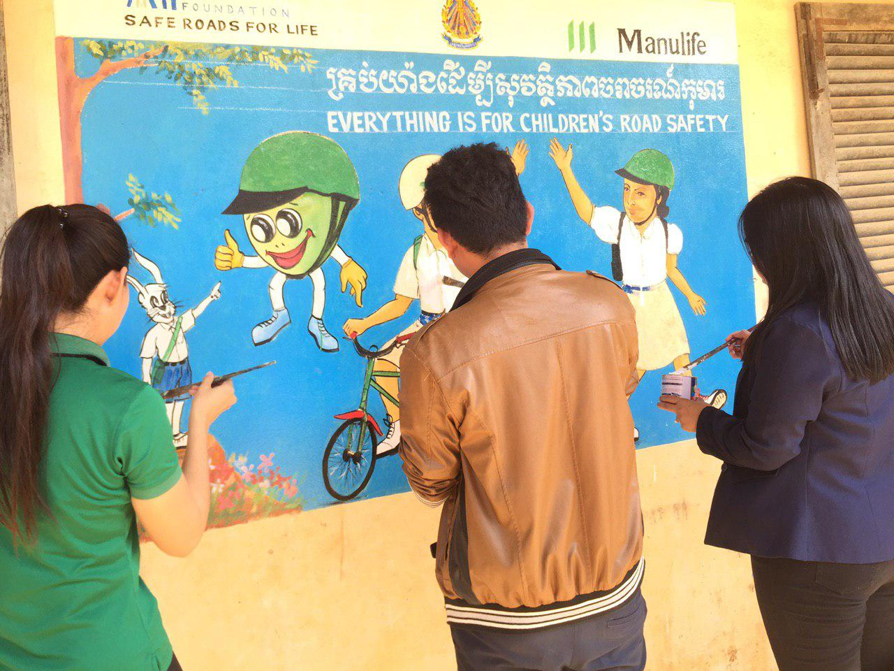 """Everything is for children's road safety"" message painted on walls of school in Cambodia"