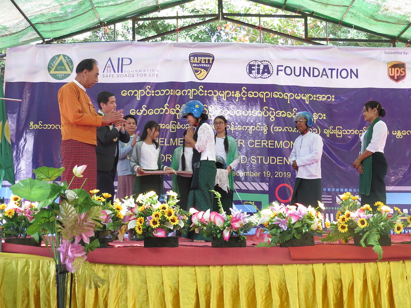 Student receives brand new helmet on stage during symbolic handover as part oftheSafety Delivered program.
