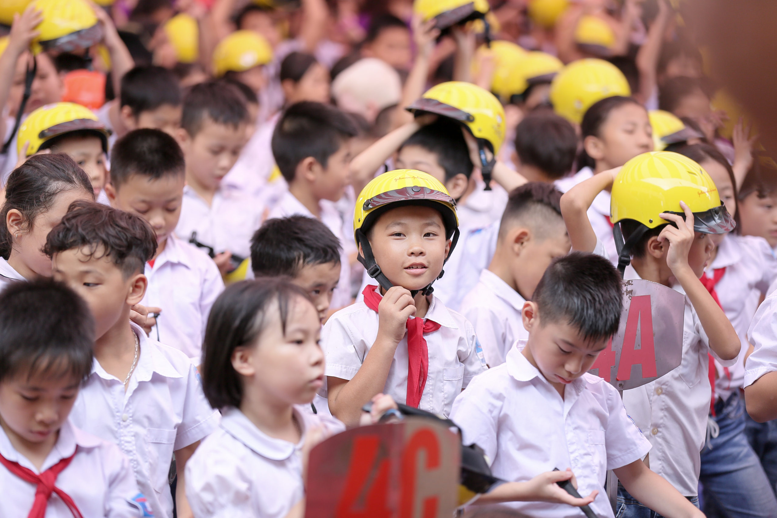 A student at a program school in Thai Nguyen, Vietnam wears his quality helmet provided through the Helmets for Kids program.